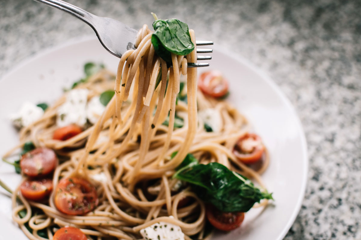 selective-focus-photography-of-pasta-with-tomato-and-basil-1279330